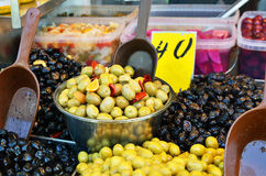 Assortment of olives, pickles and salads in bowls on market stan Royalty Free Stock Image