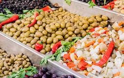 Assortment of olives and salads Stock Photos