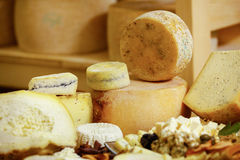 Assortment of organic gourmet cheeses Royalty Free Stock Images
