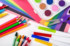 Assortment of Painting Coloring and Drawing Craft Items. Overhead view of an assortment of school craft items on a white background stock image