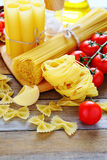 In assortment pasta with cherry tomatoes Stock Images