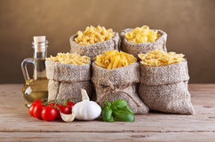 Assortment of pasta with fresh ingredients royalty free stock image