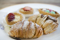 Assortment of pastries with cream or chocolate or fruit Stock Photography