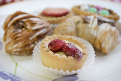 Assortment of pastries with cream or chocolate or fruit Royalty Free Stock Photos