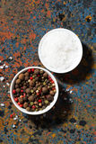 Assortment of pepper and sea salt in bowls on a dark background Royalty Free Stock Images