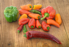 Assortment of peppers on wood Stock Images