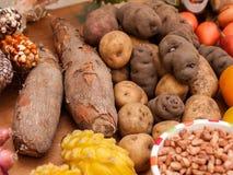 Assortment of Peruvian potatoes, corn, and yucca Stock Image