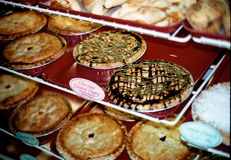 Assortment of pies in bakery. Focus is on chocolate covered cherry pie Royalty Free Stock Images