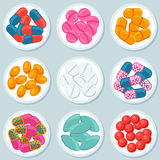 Assortment of pills and capsules in container.  Stock Photography
