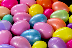 Assortment of plastic Easter Eggs. Colorful plastic Easter eggs on a table Royalty Free Stock Image