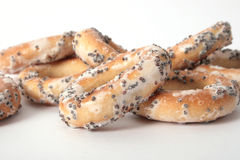Assortment of poppyseed bagels. An assortment of poppyseed bagels on a white background Stock Image