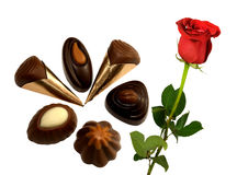 Assortment of pralines with a beautiful red rose Stock Images