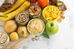 Assortment of products rich of carbohydrates. Assortment of products rich of complex carbohydrates. Healthy food on white stone background. Space for text stock photo
