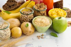 Assortment of products rich of carbohydrates. Assortment of products rich of complex carbohydrates. Healthy food on white stone background. Space for text royalty free stock images