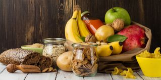 Assortment of products rich of carbohydrates. Assortment of products rich of complex carbohydrates. Healthy food on white stone background. Space for text Stock Photos