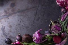 Assortment of purple vegetables. Assortment raw organic of purple vegetables mini eggplants, spring onion, beetroot, radicchio salad, plums, kohlrabi, flower Stock Photos