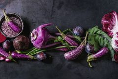 Assortment of purple vegetables. Assortment raw organic of purple vegetables mini eggplants, spring onion, beetroot, radicchio salad, plums, kohlrabi, flower Stock Photography