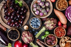Assortment raw organic of purple ingredients stock images