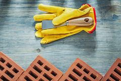 Assortment of red construction bricks leather safety gloves pale. Tte knife building concept Stock Photo