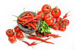 Assortment of red peppers and tomatoes on white Stock Photos