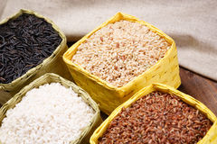 Assortment of rice. In baskets on the table Stock Photos