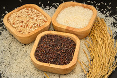Assortment of rice in wooden bowl Stock Photo