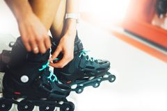 Assortment roller skates in store shop, person choosing and buy color roller-skates on backgraund sun flare, healthy royalty free stock photos