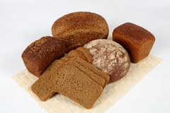 Assortment of rye bread. There are different types of rye bread in the picture. One loaf of bread that is on the left is covered by coriander. The loaf on the Royalty Free Stock Images