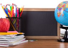 Assortment of School Suppies with Blank Chalkboard Stock Images