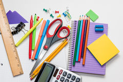 Assortment of school supplies. Isolated on a white background Stock Image