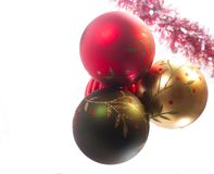 Assortment of several vintage Christmas ornaments with red garland. stock photos