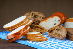 Assortment of sliced bread on a blue tablecloth Royalty Free Stock Image