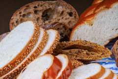 Assortment of sliced bread on a blue tablecloth Royalty Free Stock Photography