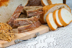 Assortment of sliced bread on a cutting board Royalty Free Stock Images