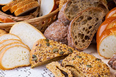 Assortment of sliced bread on a white tablecloth Stock Image