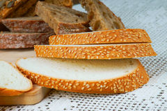 Assortment of sliced bread on a white tablecloth Stock Images