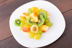 Assortment of sliced fruits on plate Royalty Free Stock Photo