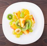 Assortment of sliced fruits on plate Stock Image