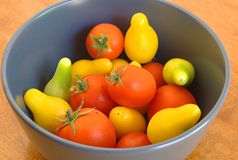 Assortment of small tomatoes in a bowl Royalty Free Stock Photography