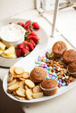 Assortment of snacks served on white platters Stock Photo