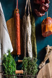 Assortment of Spanish cured meat varieties, sausages, chorizo, longaniza, lomo, charcuterie on dark background Royalty Free Stock Images