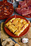 Assortment of spanish tapas. High-angle shot of some plates with different spanish cold meats and tapas, such as spanish omelette, slices of serrano ham and Royalty Free Stock Images