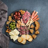 Assortment of spanish tapas or italian antipasti with meat royalty free stock image