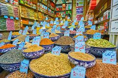 Assortment in spice stall, Vakil Bazaar, Shiraz, Iran. SHIRAZ, IRAN - OCTOBER 14, 2017: The wide assortment of cereals, spices, nuts, seeds, herbs, dried flowers royalty free stock photography