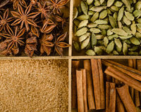 Assortment of spices in the box: star anise, cardamom, brown sug Stock Photos