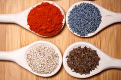 Assortment of spices with milled dried hot pepper, sesame, poppy Stock Image