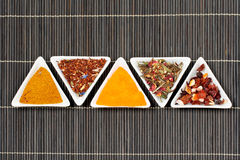 Assortment of spices over a bamboo mat Stock Photography