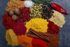 Assortment of spices seasoning on a black stone Royalty Free Stock Image