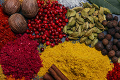 Assortment of spices seasoning on a black stone Royalty Free Stock Images