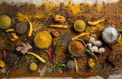 Assortment of spices in wooden bowl background royalty free stock photos